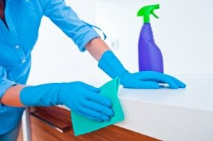 Woman Cleaning Kitchen Counter Top